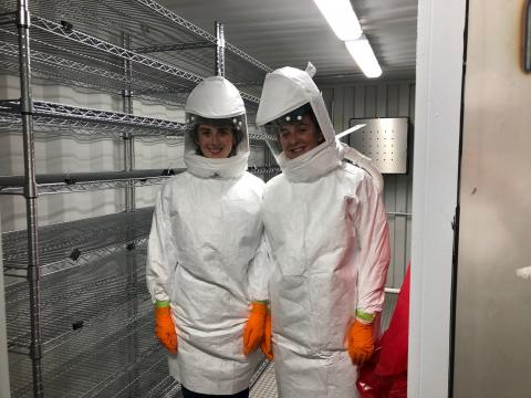 Ray and Erin Cowen inside a decon chamber